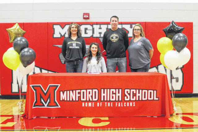 Minford High School senior Ally Coriell, seated, recently signed her national letter-of-intent to play college volleyball at West Virginia State University. Pictured with Coriell are, from left, mother Amber Coriell, father Kevin Coriell and Minford High School volleyball head coach Rachael Stapleton.