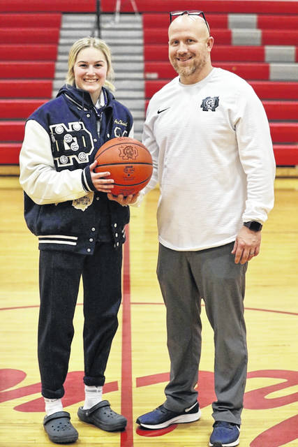 Notre Dame senior Ava Hassel and coach J.D. McKenzie celebrate Hassel breaking the Lady Titans' career scoring record during their win over Symmes Valley in SOC I play.