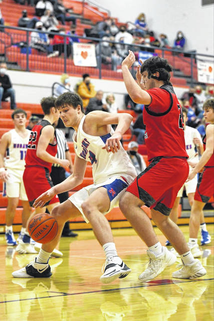 Northwest senior Brycen Carver (14) is defended by South Webster sophomore Will Collins (24) during Friday night's Southern Ohio Conference Division II contest in McDermott.