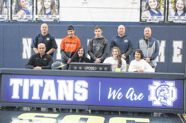 Notre Dame senior Isabel Cassidy (center-right seated) signed to continue her education and play collegiate softball while attending West Virginia Wesleyan College at a signing ceremony last Friday. Pictured are (L-R, front row:) Dan Cassidy, Amy Cassidy, Isabel Cassidy and Ann Kirby. (L-R, back row:) Matt Mader, Luke Cassidy, Alex Cassidy, Bob Boldman and J.D. McKenzie.