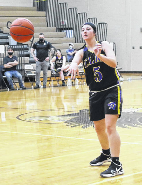 Clay's Shaley Munion passes the ball during the Lady Panthers' Division IV girls basketball sectional semifinal game at Eastern on Wednesday night.