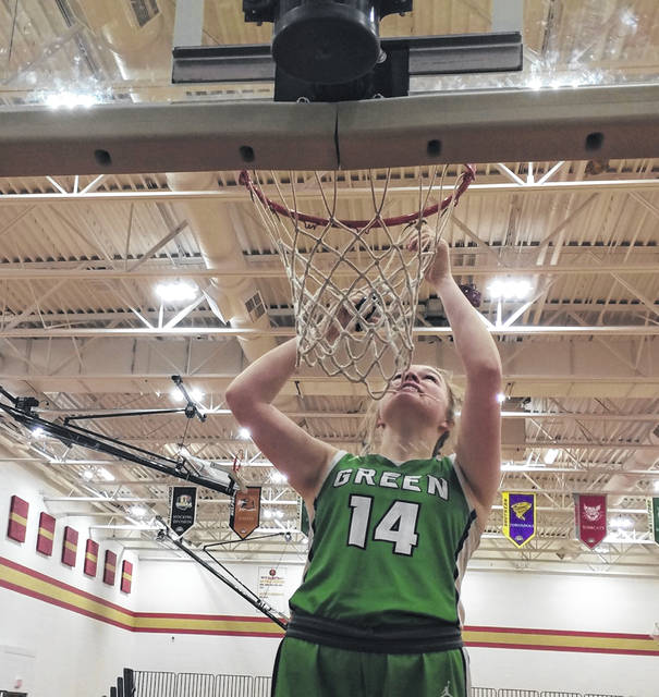 Green senior Brelan Baldridge cuts down the net following the Lady Bobcats' 59-45 Division IV sectional championship win over South Gallia on Saturday night.