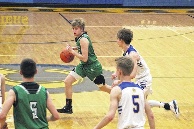 Green senior Levi Singleton (24) canned a trio of third-quarter three-pointers to help his Bobcats overcome a seven-point halftime deficit in their 53-48 road win over Clay in SOC I play.