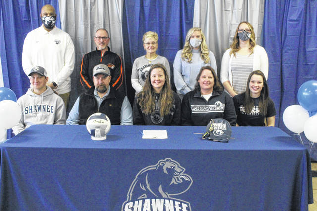 Wheelersburg High School senior Emily Boggs (center seated) has signed to continue her education and join the women's swimming and volleyball teams at Shawnee State University. Pictured are, front row from left, Joshua Boggs, Billy Boggs, Emily Boggs, Tricia Boggs and Catie Boggs; back row; Gerald Cadogan, Allen Perry, Judy Bayes, Devan Scarberry and Sydney Seth.