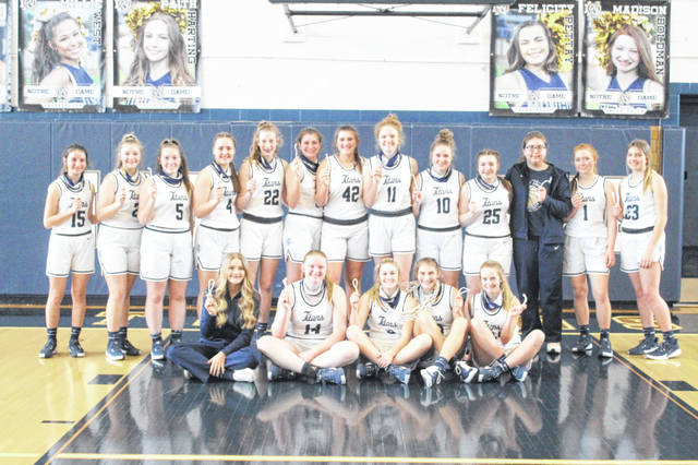 The 2020-21 Notre Dame Lady Titans captured their 11th consecutive Division IV girls basketball sectional championship on Saturday with a 66-21 win over Whiteoak at Notre Dame High School.