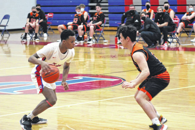 Portsmouth junior Dariyonne Bryant (3) scored a team-high 13 points in the Trojans' 68-53 win over Belpre in a Division III sectional semifinal contest.