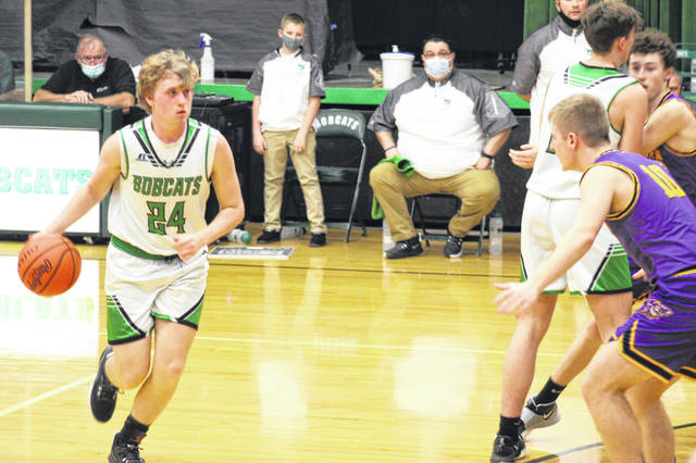Green senior Levi Singleton (24) knocked down each of the Bobcats' four made three-pointers during their 61-56 win over Southern in a Division IV sectional semifinal.