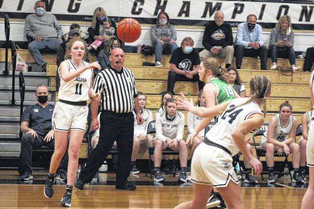 Notre Dame sophomore Annie Dettwiller (11) passes to Notre Dame senior Ashley Holtgrewe (24) during the Lady Titans' 44-22 win over Green in a Division IV district semifinal.