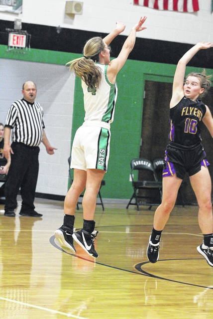 Green junior Kasey Kimbler (4) scored her 1,000th career point on this three-point attempt in the Lady Bobcats' 52-45 win over Ironton St. Joe.