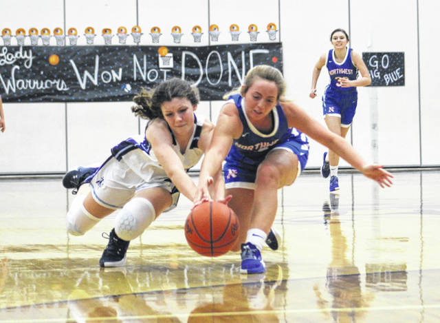 Northwest senior Terah Webb (right) and Adena's Kiera Williams (left) dive after a loose ball during Wednesday night's Division III girls basketball sectional championship game at Adena High School.