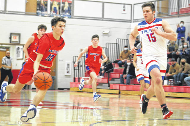 Northwest's Jay Jenkins (10) drives on a fast break as Zane Trace's Nalin Robinson (15) defends during Monday night's Division III boys basketball sectional semifinal game at Zane Trace High School.