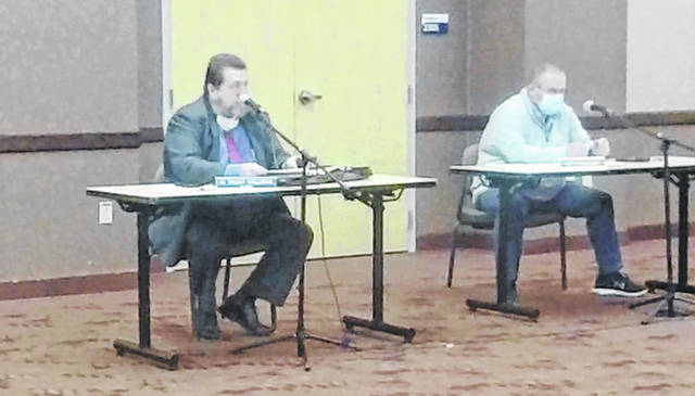 City Auditor Trent Williams (left) broke the good news of the city's 2020 finances during the Monday Portsmouth City Council meeting.