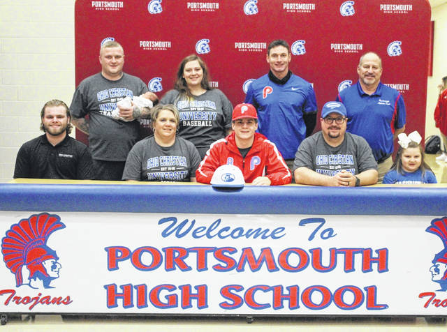 Portsmouth High School senior Hayden Yerardi signed to continue his education and baseball career at Ohio Christian University at a signing ceremony on Monday. Pictured (L-R, front row): Jacob McFarland, Tanya Yerardi, Hayden Yerardi, Chris Yerardi and Mallory Yerardi; (L-R, back row): Jacob Nunley, Katlyn Britton, Aaron Duncan and Joe Albrecht.