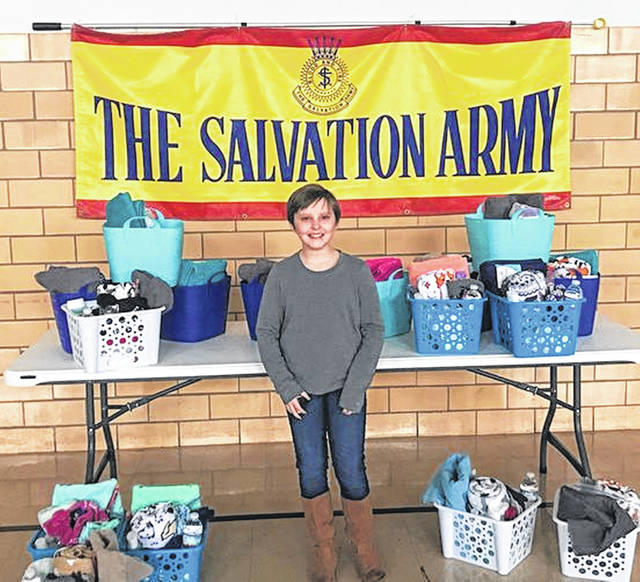 Ten-year-old Abbie Charles with some of the baskets that she made and donated to the Salvation Army.