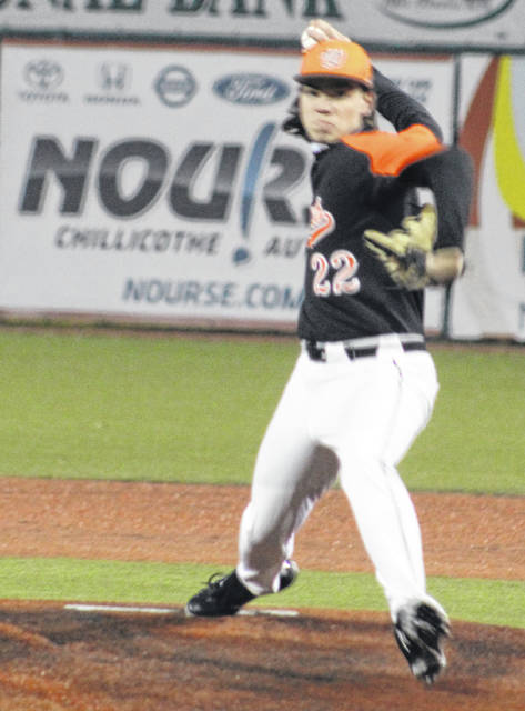 Wheelersburg starting pitcher Elias Robson (22) delivers a pitch during the Pirates' non-league season-opening baseball game against Hilliard Darby on Saturday night at Chillicothe's VA Memorial Stadium.