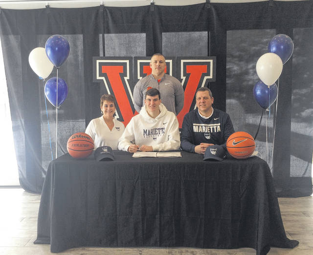 Wheelersburg High School senior Carter McCorkle, seated center, announces his intention to play college basketball at Marietta College. Seated with McCorkle are mother Jamie McCorkle and father Matthew McCorkle. Standing is Wheelersburg High School boys basketball head coach Steven Ater.