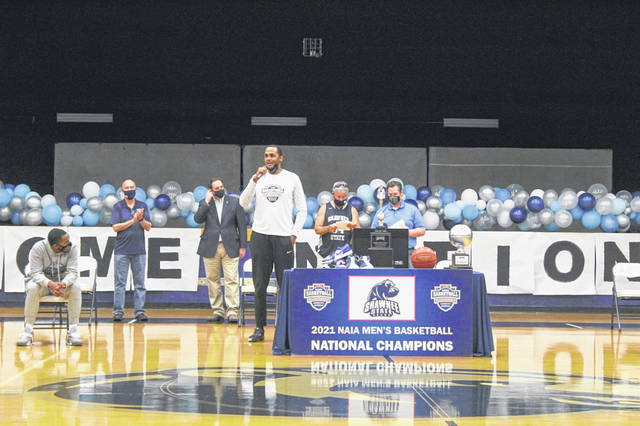 Shawnee State men's basketball head coach DeLano Thomas speaks to the crowd inside Waller Gymnasium during the celebration of his team's NAIA National Championship win.