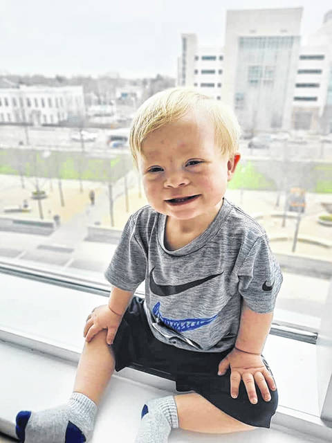 Baby Cohhen Grate, now a 16-month-old little guy is sitting in his window at Children's Hospital in Columbus, while he waits on a heart, but he is still as cute as ever.