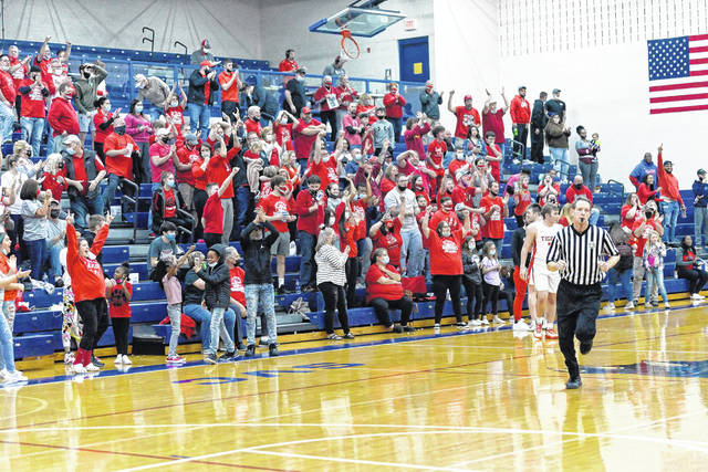 The large New Boston boys basketball crowd celebrates following the Tigers' 50-48 victory over Grandview Heights in Tuesday night's Division IV regional semifinal.