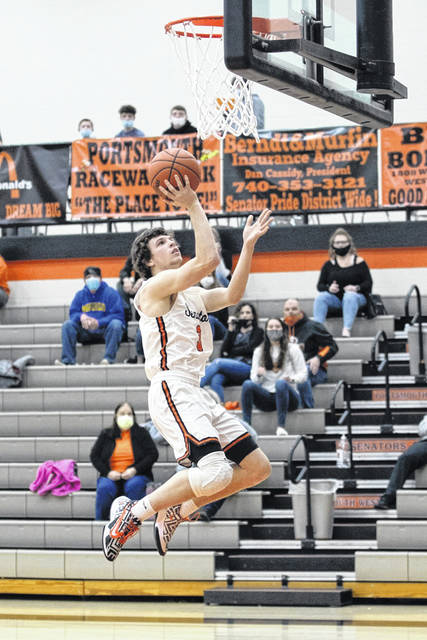 West senior Luke Howard (3) goes in for an uncontested layup during the Senators' sectional championship game on Friday night against Ironton.