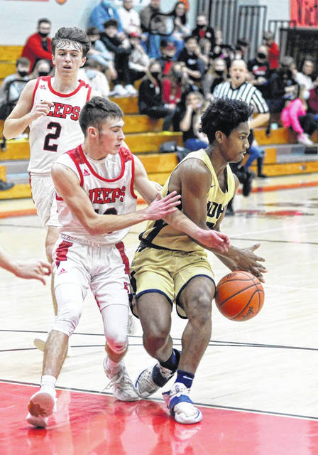 Notre Dame junior Jermaine Powell (2) is defended by South Webster sophomore Jaren Lower (10) during their Division IV sectional championship game played at SWHS.
