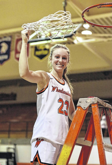 Wheelersburg senior Kaylee Darnell (23) scored a game-high 31 points in the Lady Pirates' 68-47 win over Coal Grove in Saturday's Division III district championship played at Ironton' High School's Conley Center.