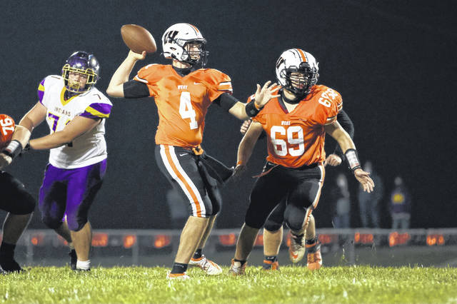West senior Luke Wroten (69) looks to block for quarterback Mitchell Irwin (4) during the Senators' 28-14 win over Valley in a Southern Ohio Conference Division II football game last season.