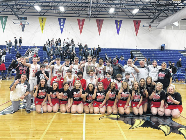 The 2020-21 New Boston Tigers are the Division IV boys basketball regional champions following Friday night's 44-39 win over Berlin Hiland inside Larry Jordan Gymnasium at Southeastern High School.
