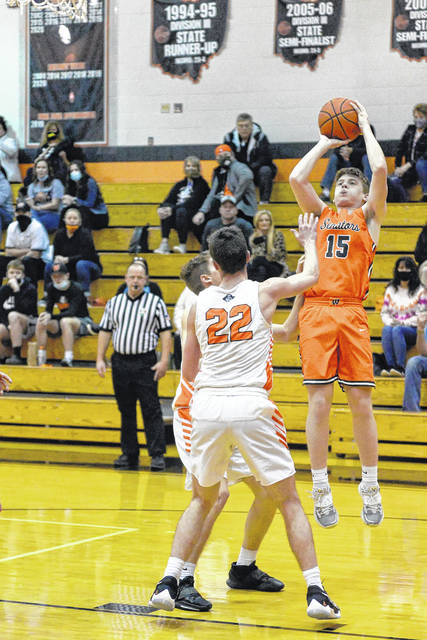 West junior Noah Coleman (15) attempts a mid-range jumper during the Senators' meeting with Wheelersburg in a Division III district semifinal.