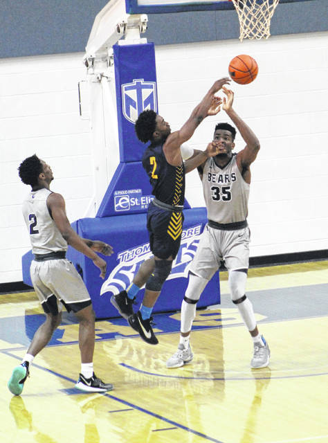 Shawnee State's E.J. Onu (35) alters the shot of West Virginia Tech's Darrin Martin (2) during Saturday's NAIA Opening-Round Tournament game at Thomas More University.