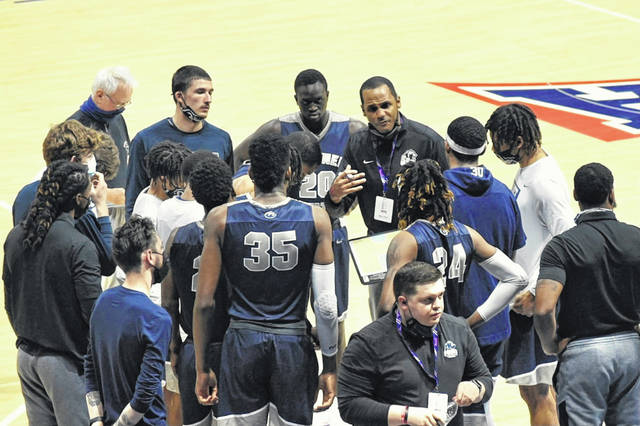 Shawnee State men's basketball coach DeLano Thomas instructs his players during a timeout in the Bears' NAIA National Semifinal win over Saint Francis (Ind.) on Monday night.