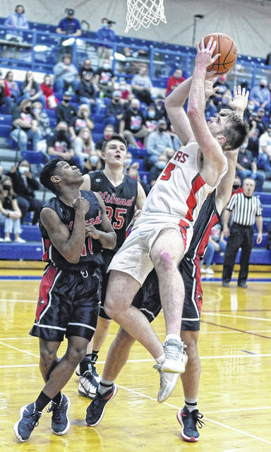 New Boston senior Kyle Sexton (13) attempts to score over three Hiland defenders during the Tigers' 44-39 win in Friday night's Division IV regional championship game.