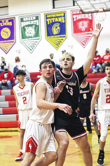New Boston senior Kyle Sexton (13) posts up a Symmes Valley defender during the first meeting between the Tigers and Vikings in Willow Wood earlier this season. <em>(File photo)</em>