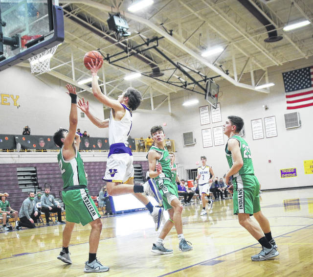 Valley sophomore George Arnett (1) goes up for a layup between three Western defenders during Wednesday night's Division IV boys basketball district semifinal game at Valley High School.