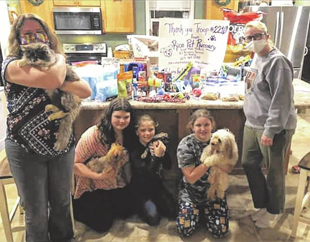 Some of Girl Scout Troop 2210 out of West Portsmouth holding some of the animals that they were able to help with their donations.