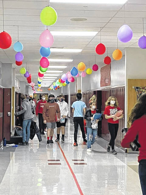 The decorated hallway of the Middle School with students returning all together again.