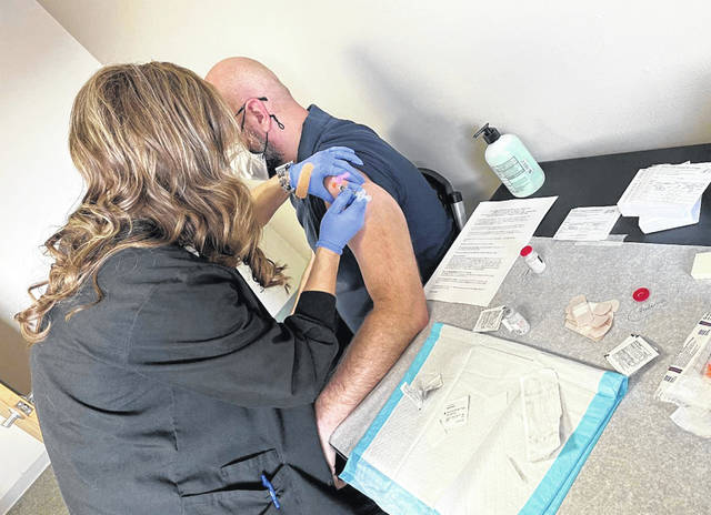 Scioto County teachers and school staff signed up to receive their first dose of COVID-19 vaccine last week at the school districts' health clinic, Scioto Advantage, in New Boston.