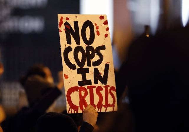 Protesters march up North Front Street, demonstrating against Monday's fatal shooting of a Black man in downtown Columbus, Ohio, on Tuesday, April 13, 2021. Miles Jackson was shot and killed inside Mount Carmel by police in Westerville, Ohio.  (Kyle Robertson /The Columbus Dispatch via AP)