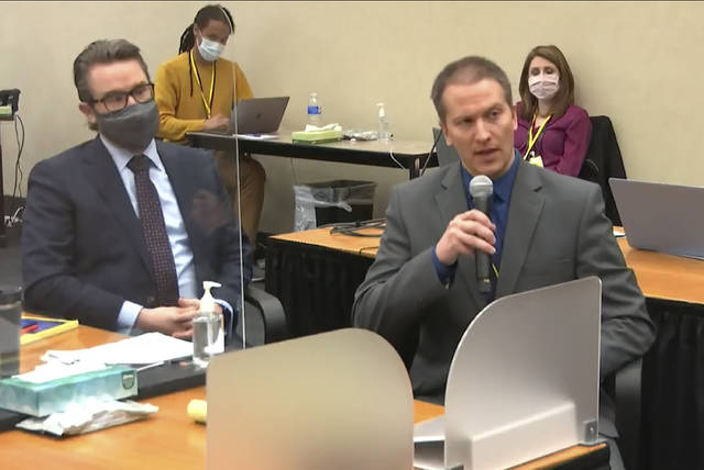 FILE - In this April 15, 2021, file image from video, defense attorney Eric Nelson, left, and former Minneapolis police Officer Derek Chauvin address Judge Peter Cahill at the courthouse in Minneapolis during Chauvin's trial in the death of George Floyd. (Court TV via AP, Pool, File)