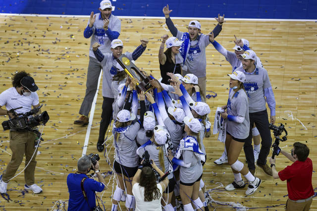 Kentucky players hold the trophy after a win against Texas in the final of the NCAA women's volleyball championships Saturday, April 24, 2021, in Omaha, Neb. (AP Photo/John Peterson)
