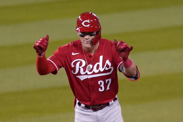 Cincinnati Reds' Tyler Stephenson gestures toward his bench after hitting a double during the fourth inning of a baseball game against the Los Angeles Dodgers Monday, April 26, 2021, in Los Angeles. (AP Photo/Mark J. Terrill)