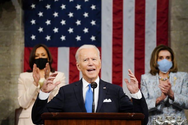 Vice President Kamala Harris, and House Speaker Nancy Pelosi of Calif., stand and applaud as President Joe Biden addresses a joint session of Congress, Wednesday, April 28, 2021, in the House Chamber at the U.S. Capitol in Washington. (Melina Mara/The Washington Post via AP, Pool)