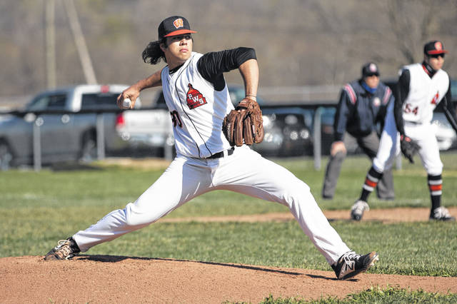 West pitcher Rodney Moore (30) delivers a pitch to a Wheelersburg batter during Friday's Southern Ohio Conference Division II baseball game at West High School.