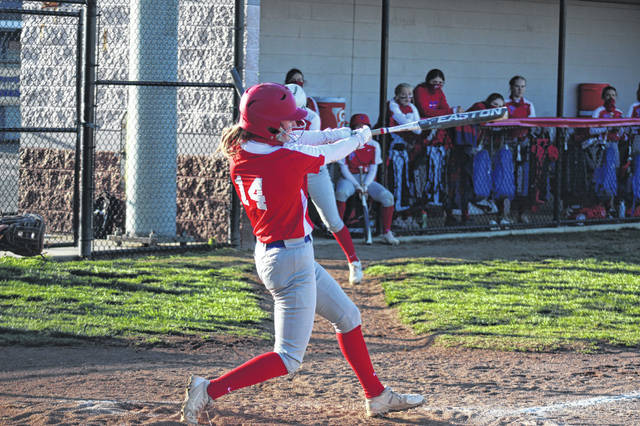 Portsmouth junior Madison Perry (14) went 2-of-3 at the plate and drove in two runs during the Lady Trojans' home win over Clay.