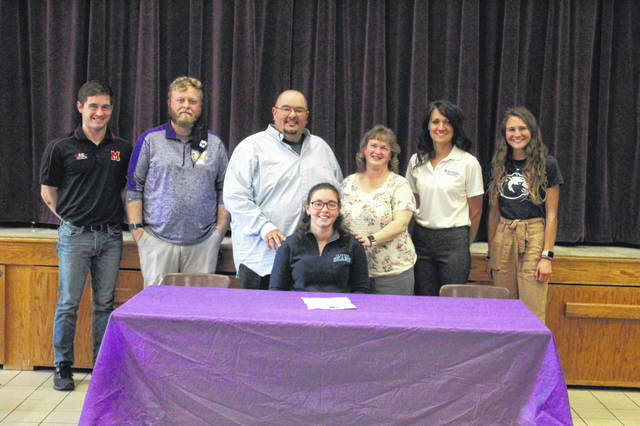 Valley High School senior Abbi McKinney (seated) signed to continue her education and join the women's cross country team at Shawnee State University in a recent signing ceremony held inside the Valley High School cafetorium. Pictured (L-R): Ryan Higbee, Ryan Conley, Rob McKinney, Abbi McKinney (seated), Becky McKinney, Ann Marie Allen, Jessica Price.