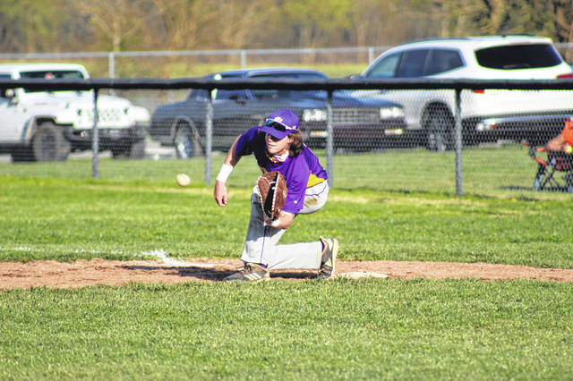 Valley senior Breckon Williams (2) fields a ball at first base during the Indians' win over West in SOC II play.