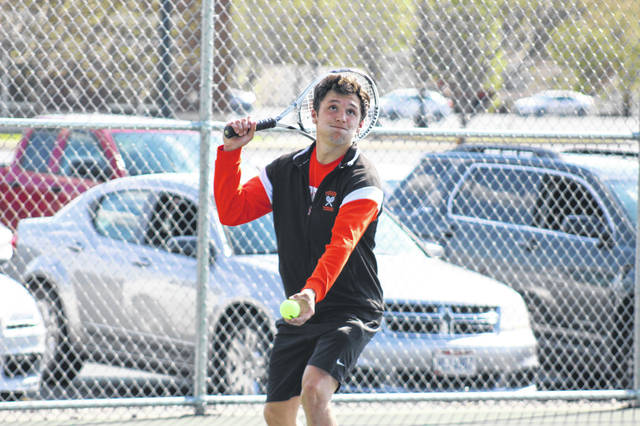 Wheelersburg senior Logan Davis defeated Minford senior Sam Wiehle in the No. 1 singles match between the Pirates and Falcons.