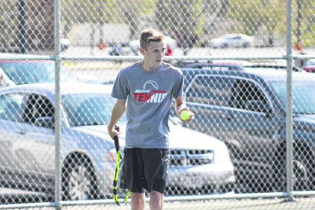 Minford senior Sam Wiehle prepares to serve during a Falcons tennis match earlier this season.