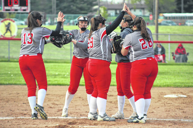 Minford freshman Addison Lute (29) and her Lady Falcon infield teammates prepare for an inning of defense in their Southern Ohio Conference Division II contest versus South Webster.