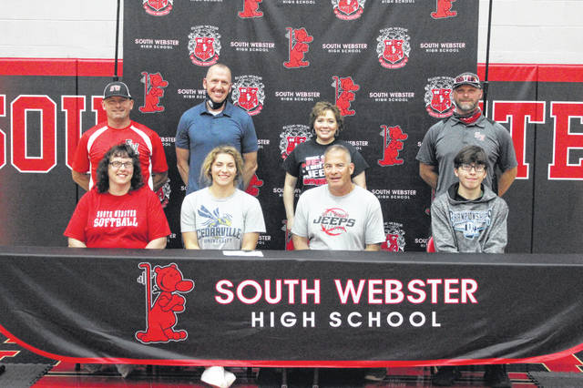 South Webster senior Emma Bailey signed to continue her education and softball and indoor track careers at Cedarville University. Pictured (L-R, seated): Jane Bailey, Emma Bailey, John Bailey, Evan Bailey; (L-R, standing): Jason Hamilton, Jeremy Newman, Lori Newman, Andy Messer.